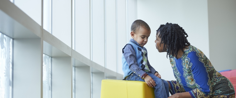 Child talking with doctor