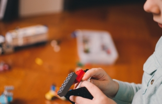 young child playing with toys indoors